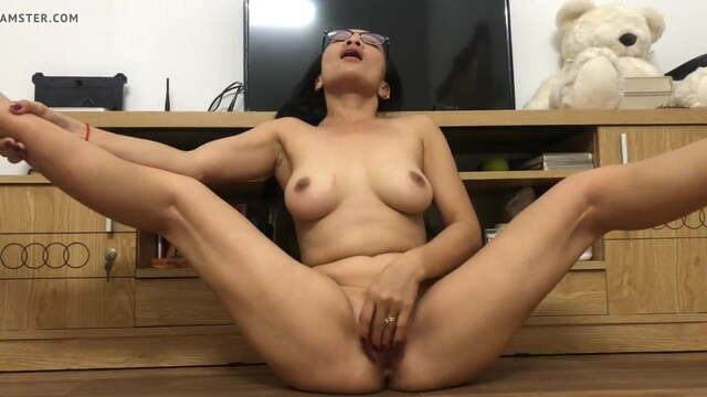 Asian Mom Plays with Her Pussy