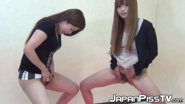 Shy Japanese Babes Show off Hairy Pussy While Pissing fr